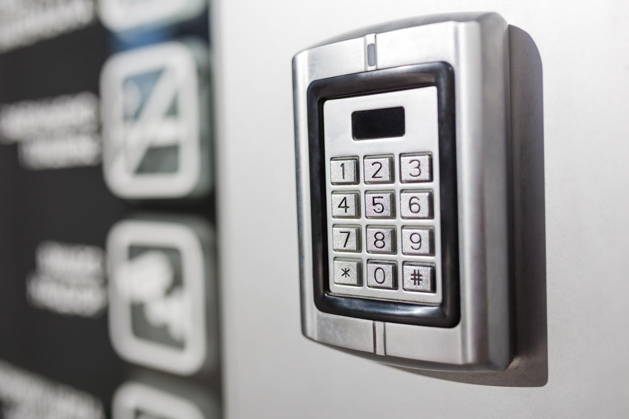 Metal intercom electronic access control door box with numeric keypad.